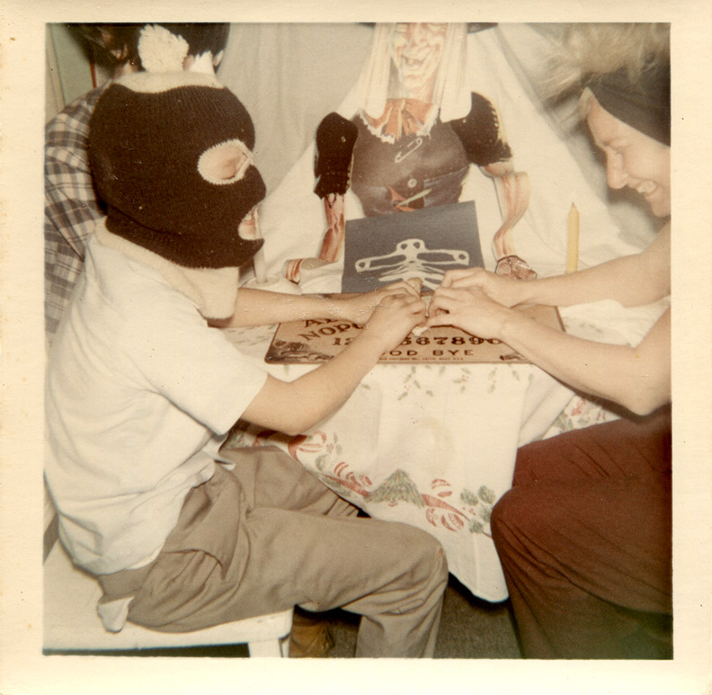 1960s masked kid playing ouija